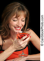 Good Times - A beautiful woman laughing over a coctail.