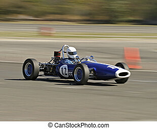 Antique blue racecar - Vintage blue racecar during a race