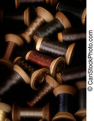 thread - assortment of colored thread on vintage wooden...