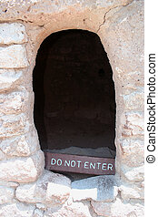Do Not Enter sign in opening of an ancient Anasazi dwelling...