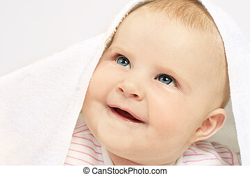 Babys Got Blue Eyes - Adorable baby under a towel, looking...
