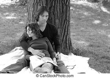 Couple in love - Attractive couple relaxing in the park