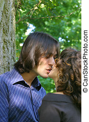 Kissing couple - Young couple kissing in the park
