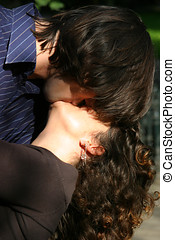 Kissing couple - Stealing a kiss