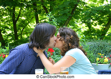 Kissing couple - Attractive couple kissing in the park