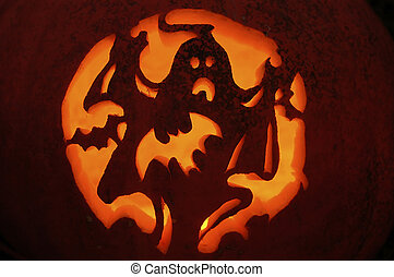 Pumpkin Carving - Carved pumpkin showing ghost, bat, and...