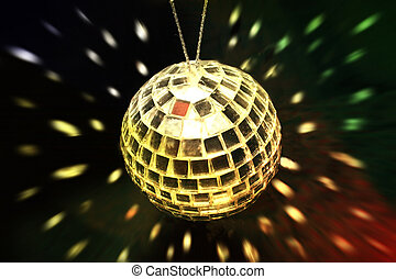 golden disco ball - golden ball with reflections around the...