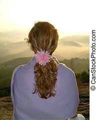sunrise meditation - woman meditating at sunrise on hilltop,...
