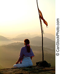 sunrise meditation & - woman meditating at sunrise next to...
