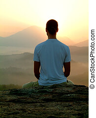 sunrise meditation - man meditating during sunrise