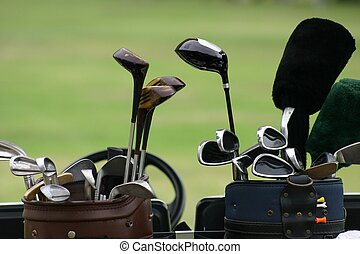Golf Clubs 2 - Close up of two sets of golf clubs