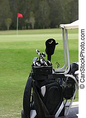 Golf Clubs on Cart - Close up of golf clubs on cart with...