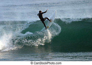 Surf's Up - Malibu surfer taking a wave head-on.