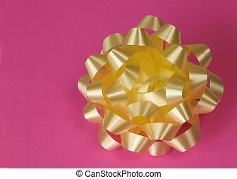 yellow bow - yellow gift bow on pink background