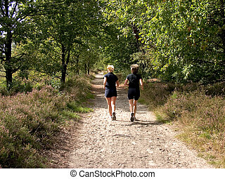 Two women Jogging. - Jogging in the forest. Two women doing...