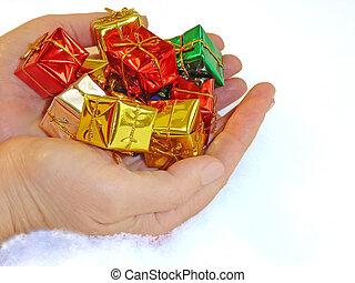 Generosity - Two hands giving present.