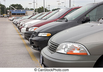 Vans for sale - A row of new vans for sale on this dealer's...