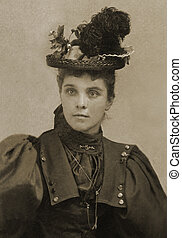 single hat - Victorian woman in fashionable attire and...