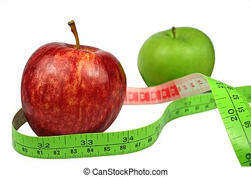 Fruit Diet - Fruit diet - two apples with tape measure on...