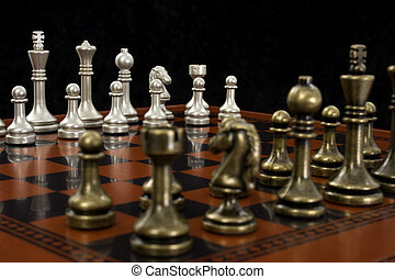 Chess Game - Wooden chess board with metal peices. Shot in...