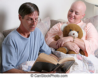 Providing Comfort 1 - A man reading the bible to a cancer...