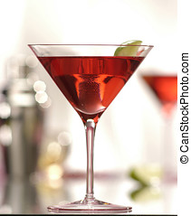martini - red martini with lime,soft focus on lime and...