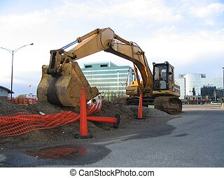 construction zone - excavator in a work area waiting to...