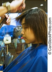 Hair Cutting - Asian girl cutting her hair