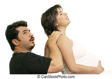 Easing back pain - Husband massages a pregnant young woman...