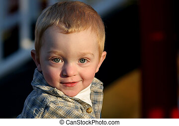 young redheaded boy - portrait of a young, redheaded boy in...