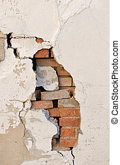 brick wall revealed - crumbling wall with revealed brick...