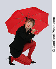 Red umbrella - Businesswoman with a red umbrella looking up