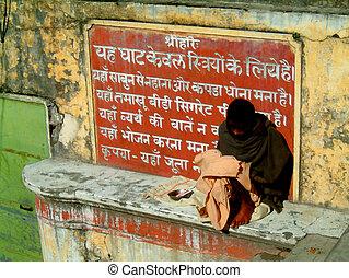 sanskrit beggar - beggar sitting infront of sanskrit prayer...