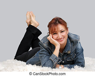 Relaxing at home - Casual woman relaxing on the floor
