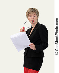 Businesswoman with eyeglasses reading a paper