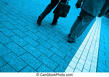 Men Walking - Blue toned photo of two business men walking,...