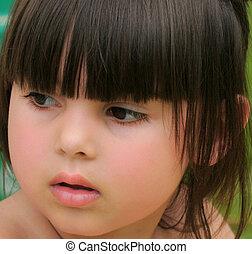 Rosebud Lips - Face of a little girl with rosebud shaped...