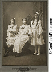 janes - Black white photograph of four Victorian children...