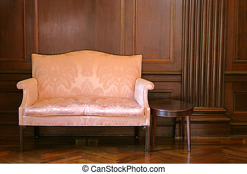 Antique Setting - Antique sofa & stand against a textured...