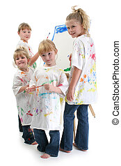 Four Girls Painting At Easel - Four girls in big white...