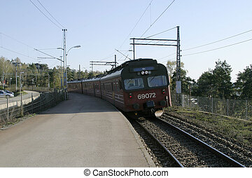 Local Train in Oslo - Train coming to Ljan stasion in Oslo,...