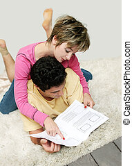 Sweet young couple reading instruction manual
