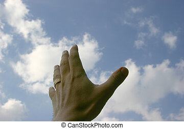 Hand reaching for sky