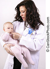 Medicating baby - A doctor medicating a baby.