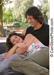 Lounging couple - Attractive young couple lounging outdoors