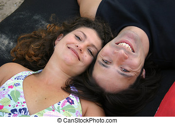 Opposites - Attractive young couple lying next to each other