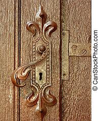 Antique handle - Old door locking system. Door wood with...