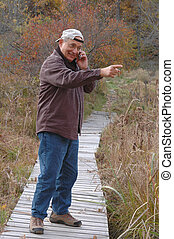 man in wilderness 236 - man in wilderness on cell phone 236