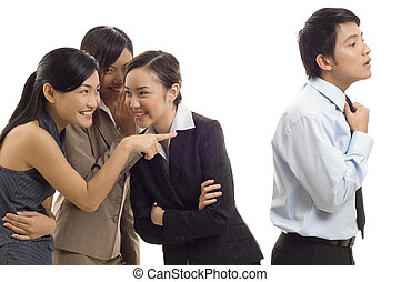 Office Gossip 1 - Three attractive young asian businesswomen...