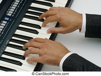 playing piano - mans hands playing the piano